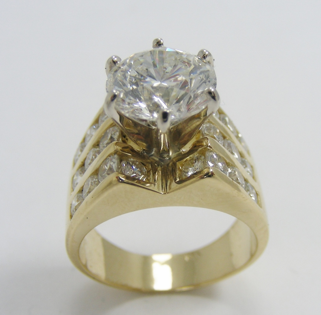 Three channel diamond ring with white gold head