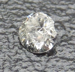 White Round Brilliant Diamond badly chipped