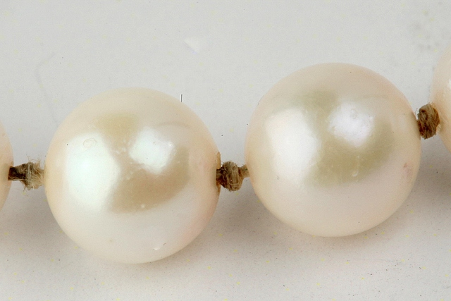 White Pearls with Dirty Knots