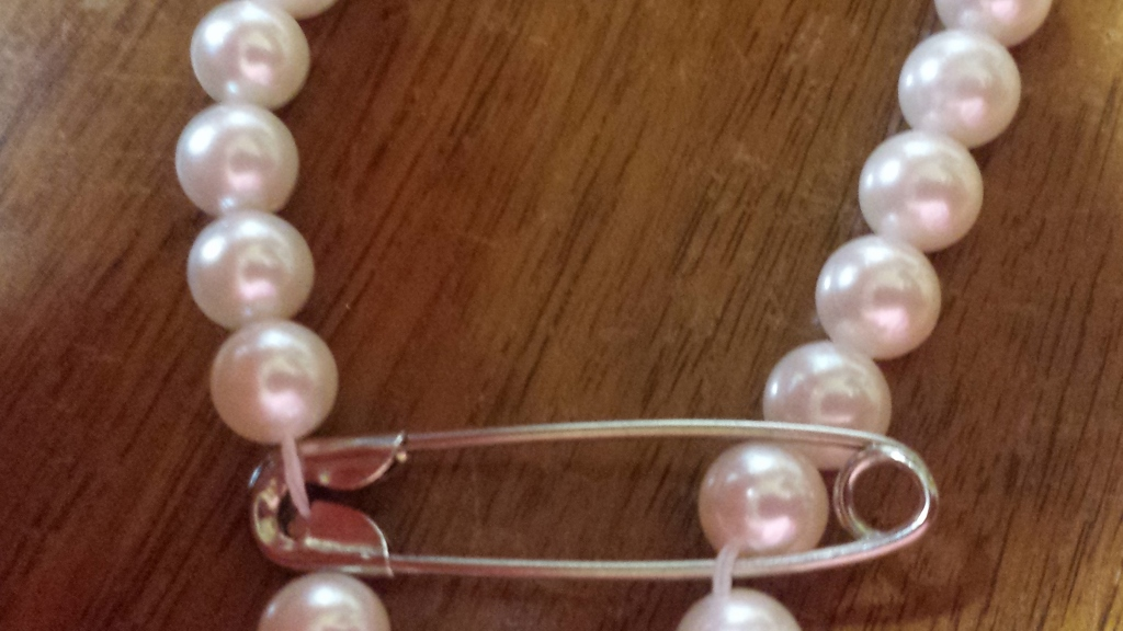 Safety Pins and Pearls Don't Mix! Restring those pearls.