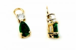 Pear shaped emeralds with diamond accents as ear charms