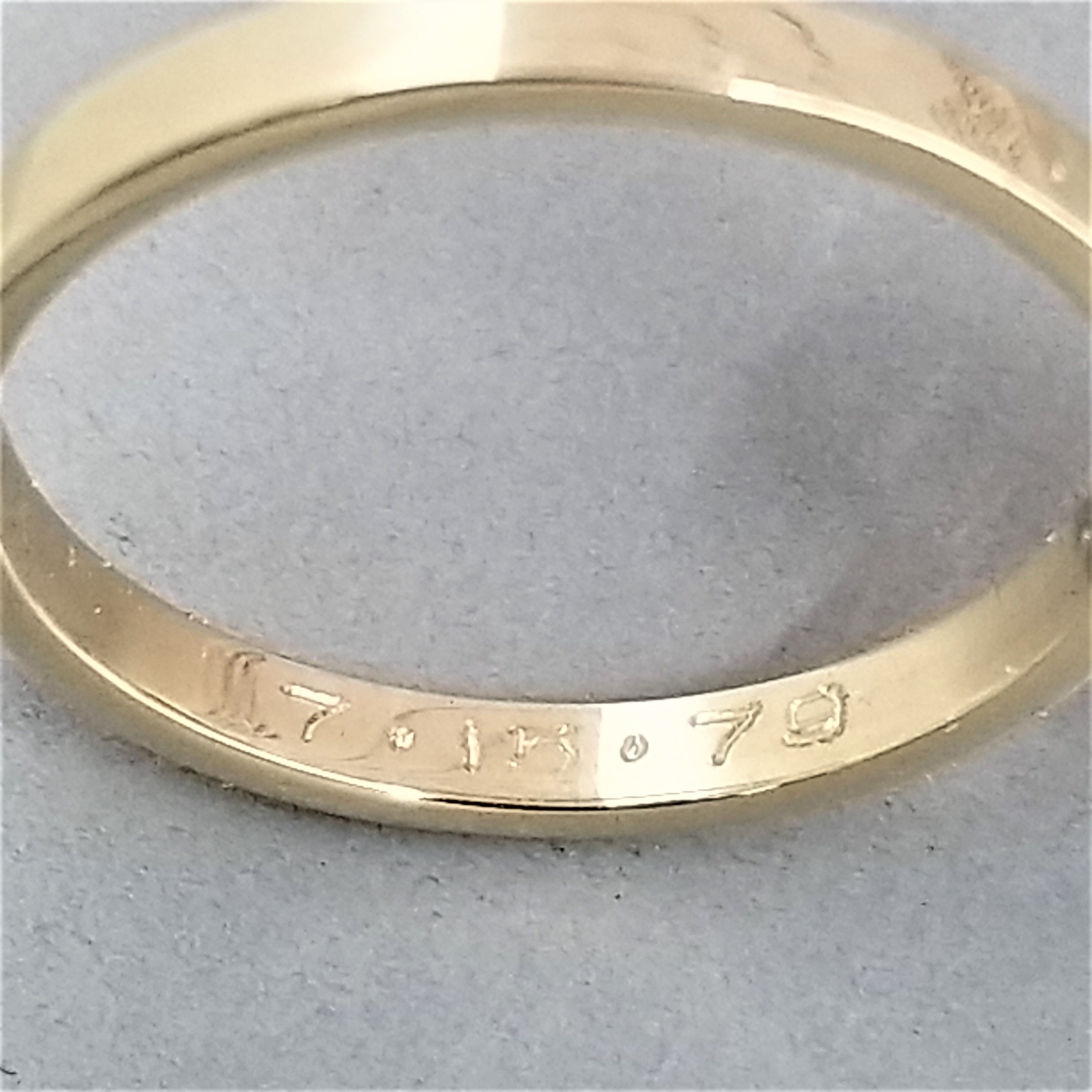 thin wedding band inscription engraved by machine