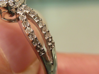 Crappy Diamonds in Shared Prongs Ring, Wedding ring buyer beware