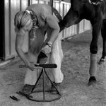 Horse shoeing woman