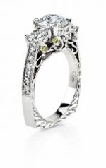 Filigree detail in three diamond engagement ring. Width and height too