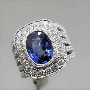 Wedding ring with bezel sapphire and five rows of diamonds