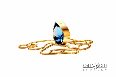 Pear Shaped Blue Topaz Bezel Set Gem Pendant On Snake Chain