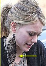 Hilary Duff in big earrings