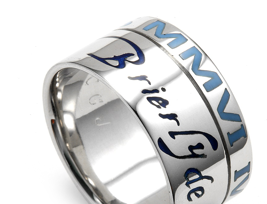 Enamel colors of blue in lettering on man's wedding band