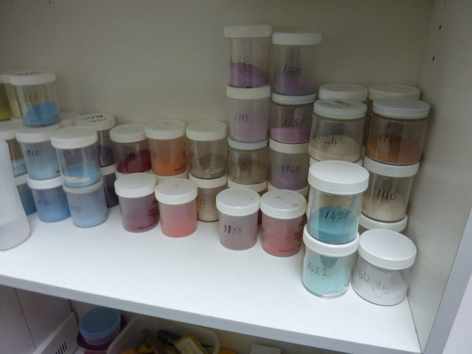Enamel Powders in different colors on a shelf