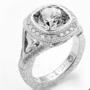 White gold engraved vintage style engagement ring with cushion cut diamond