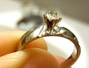 White gold ring with bent back prongs