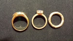 Three yellow gold rings. Each is a different yellow.