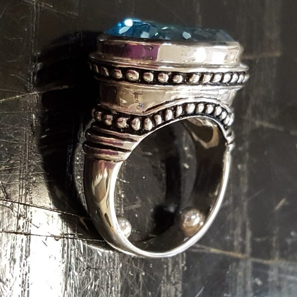 silver ring with raised details and oxidation