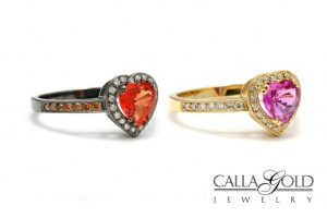 On the Left, a Black Rhodium Finished Heart Ring. On the Right a Yellow Gold Heart Ring