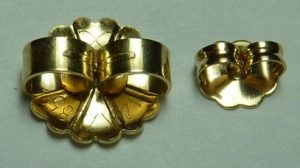 Large Monster back next to normal size ear backing - Calla Gold Jewelry