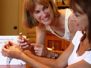 Personal Jeweler showing client to use a loupe