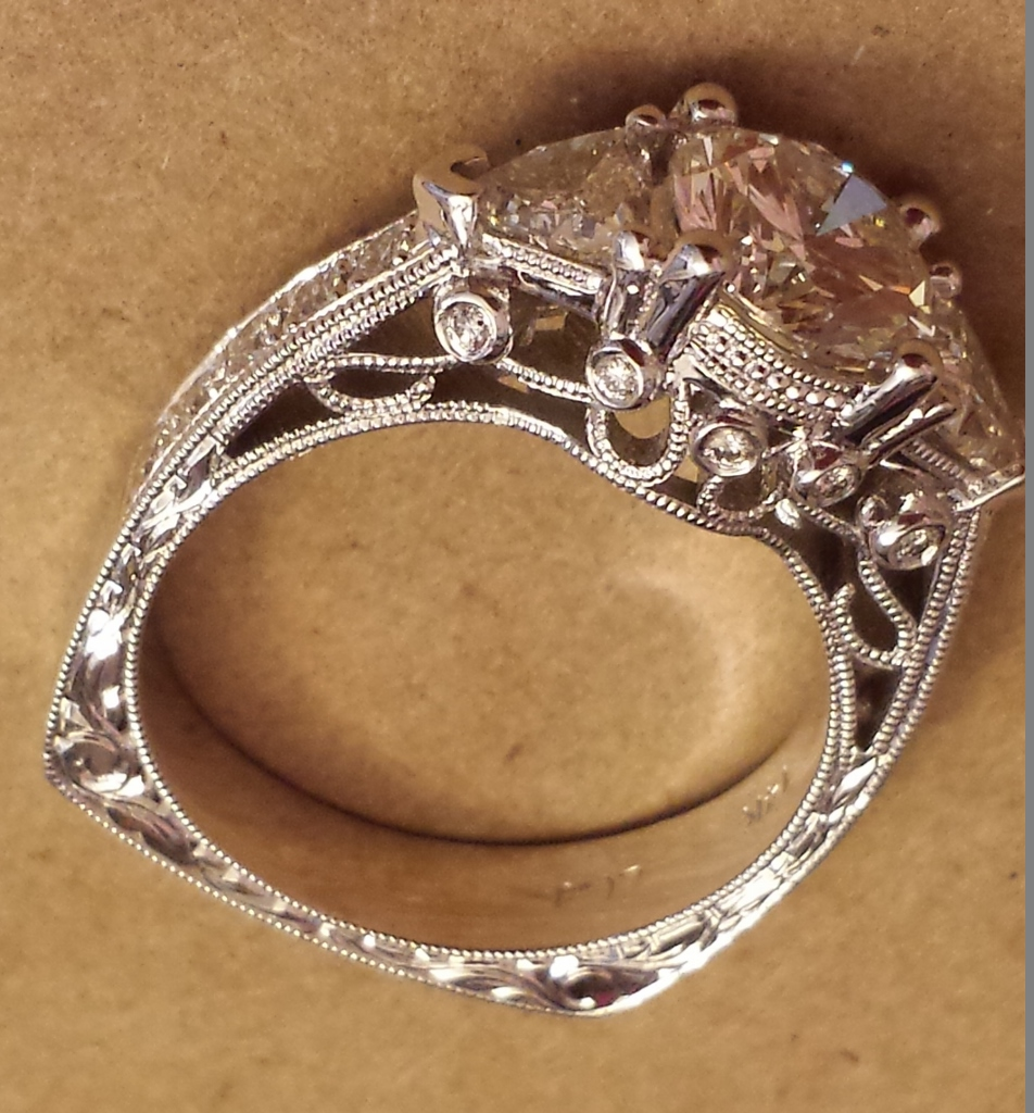 Milgrain and hand engraving on a diamond engagement ring Calla Gold jewelry