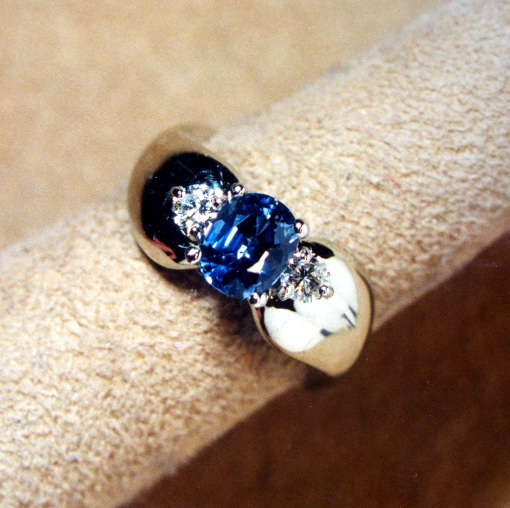 This sapphire and diamond ring was redesigned with a flatter profile.