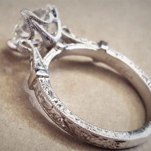 Hand engraved engagement ring with details