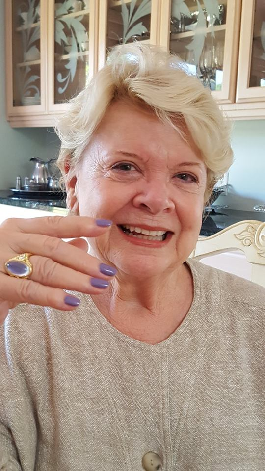 Happy client with rainbow moonstone ring from Calla Gold