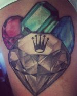 Jeweler tattoo with gemstones