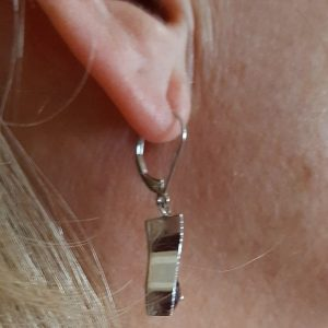 Lever back holding dangle earrings side view