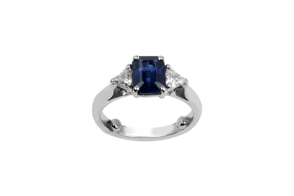 Emerald cut sapphire and trillian diamonds engagement ring