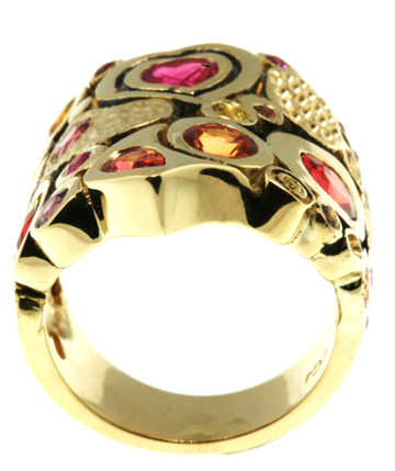 Yellow gold ring with multiple gems and oxidation between gems