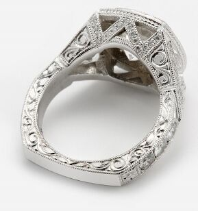 Hand engraved side walls of engagement ring