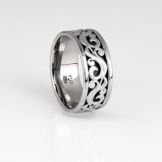 Man's band ring with swirls and black oxidation