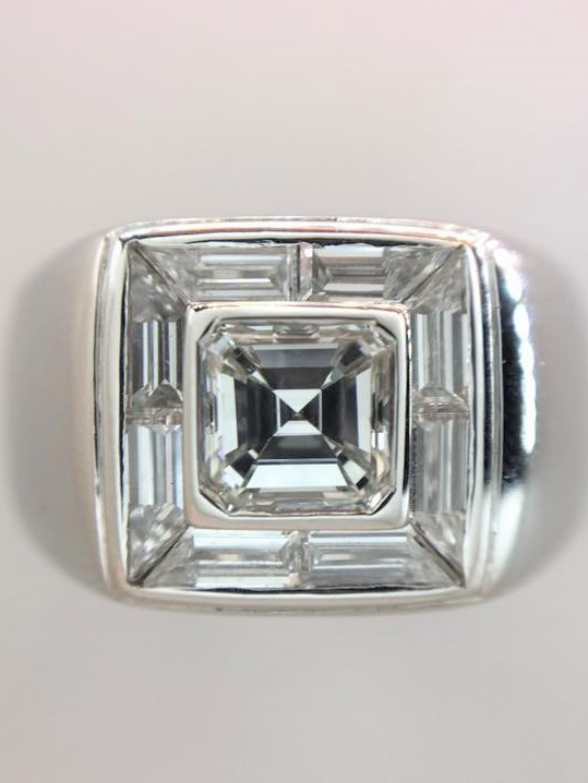 Mans ring with cushion center diamond and baguette diamonds around
