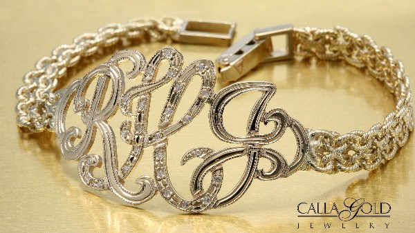 Yellow gold watch band made into a monogram bracelet