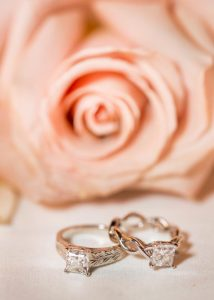  Edible magazine. Two white gold wedding rings for ladies. Princess cut diamonds with engraving and intertwined designed rings.