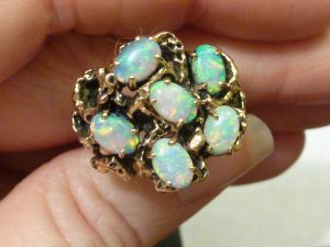 opal ring in 60's yellow gold design