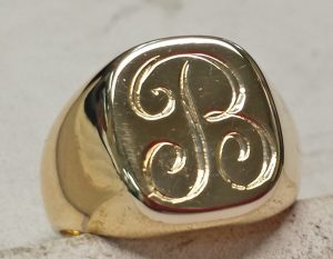 Hand engraved B on yellow gold signet ring