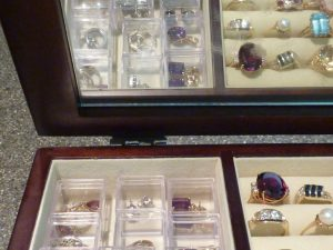Organizing Pendants and earrings in clear plastic tiny boxes