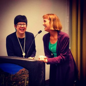 Calla Gold at Tucson Gem Show Educational Presentation with Peggy Jo Donahue . Calla and Peggy standing at the lectern