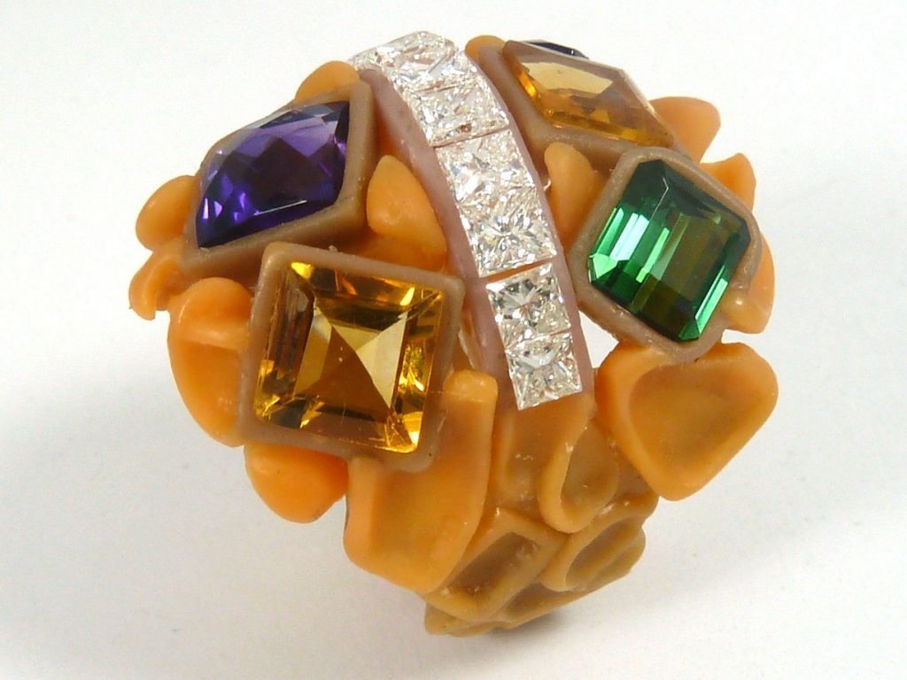 Wax of ring design holding the square gemstones
