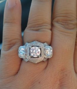   mysparkly.com screen shot. Three diamond ring with halos in vintage style in white gold