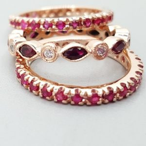 Three eternity bands. Two all round ruby eternity bands and ruby and diamond marquis and round diamond eternity band. eternity band sizing