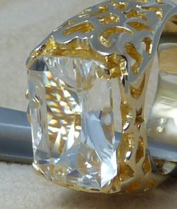 White Topaz ring with open work on the shank