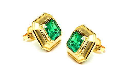 Bezel set emeralds in beveled design