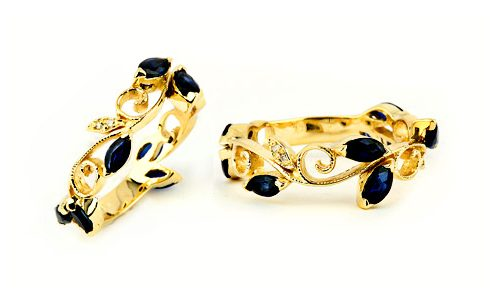 three quarter eternity bands in yellow gold with sapphire and diamond