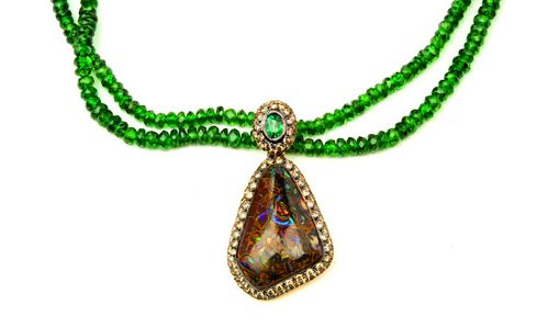 Yawah nut opal in bezel with champagne diamonds with a tsavorite beads necklace.