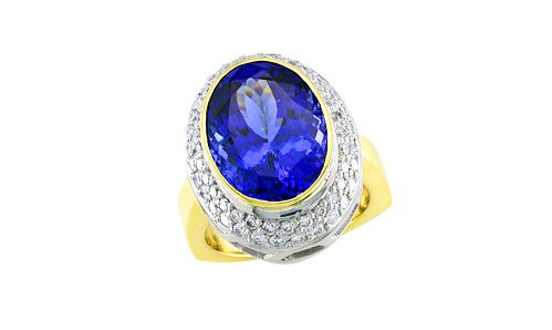 Oval tanzanite surrounded by pave diamonds ring