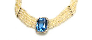 large aquamarine pendant with halo of diamonds in pearl five strand necklace